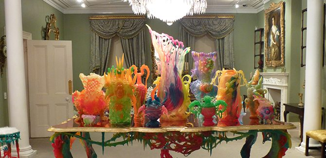 The Green Drawing Room, installation by Kate Rohde, English glass chandelier (c.1820), (The Johnston Collection). Hair Chandelier (2017) detail, resin, acrylic hair, site specific, dimensions variable. Rave Cave Dining Table (2015), resin, mixed media, (excluding vases) 90 x 250 x 130 cm. Rave Cave Dining Chair (2015) detail, resin, mixed media, 140 x 50 x 50 cm. (Photo: Inga Walton).